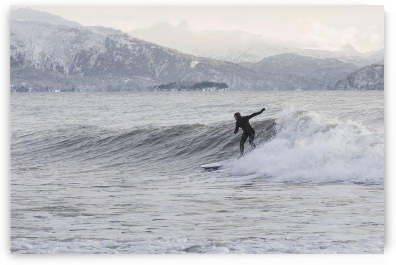 Person surfing in winter in Homer, Kenai Peninsula, Kachemak Bay, Alaska. by PacificStock