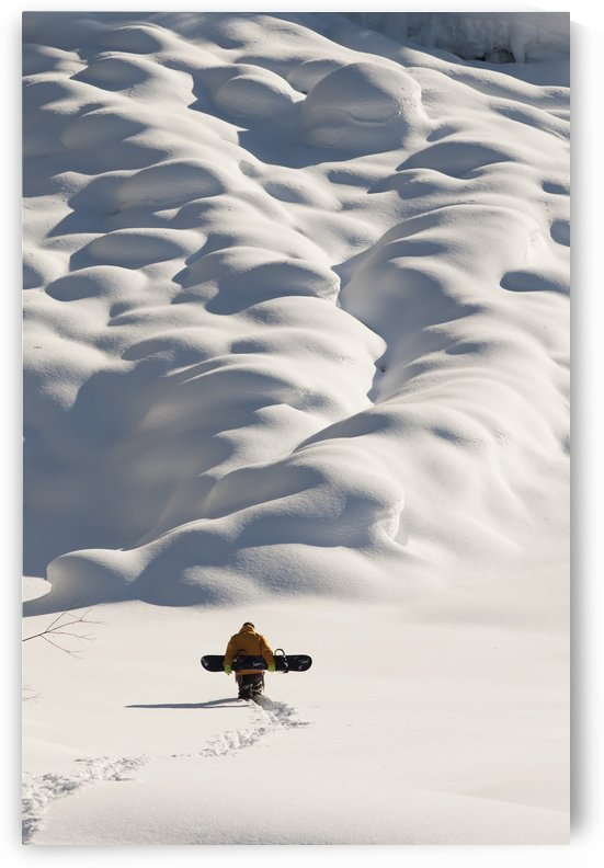 Person walking with a snowboard in mountains above Haines, Southeast Alaska, USA by PacificStock
