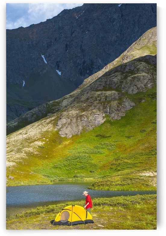 A man at his campsite at Hanging Valley in South Fork near Eagle River on a summer day in South Central Alaska. by PacificStock