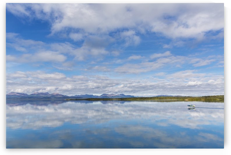 Light clouds reflect on the calm water of Tikchik Lake at the Tikchik Narrows Lodge, Wood Tikchik State Park, Southwestern Alaska; Alaska, United States of America by PacificStock