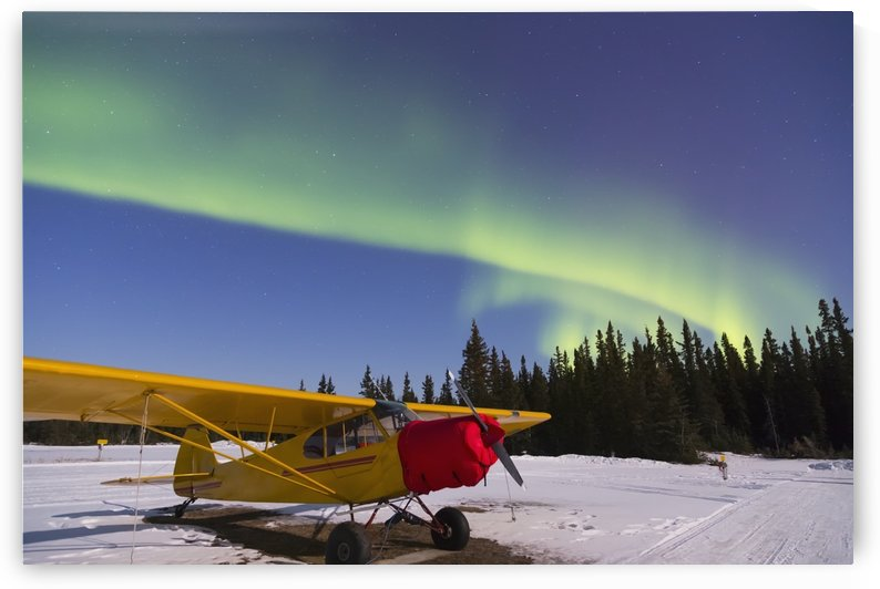 Plane beneath the aurora borealis at the Delta Junction airstrip; Alaska, United States of America by PacificStock