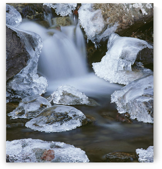 Blurred Motion Of Creek Surrounded By Ice Sc Alaska by PacificStock