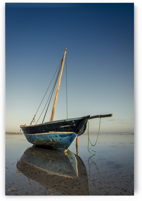 Dhow in low tide; Pemba, Cabo Delgado, Mozambique by PacificStock