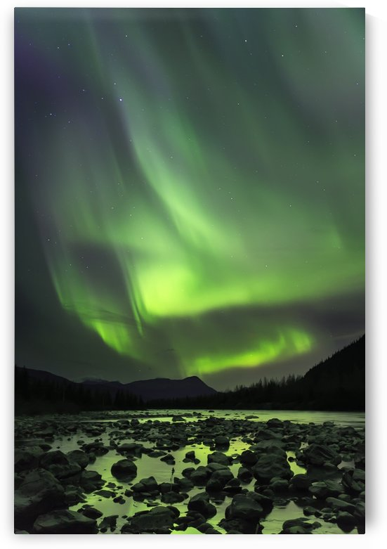 A bright aurora engulfs the Northern skies over Portage River; Alaska, United States of America by PacificStock