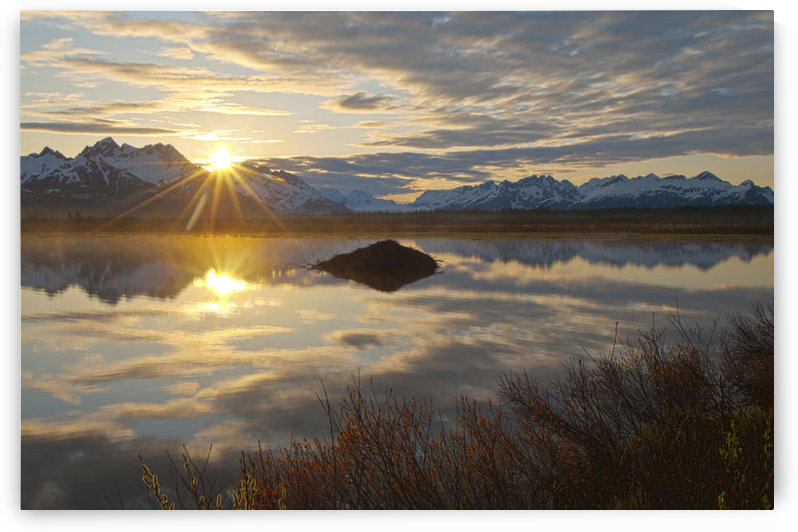 Sun Rises Over The Chugach Mountains With A Pond And Beaver Lodge In The Foreground, Copper River Highway, Chugach National Forest, Southcentral Alaska, Spring, Hdr by PacificStock