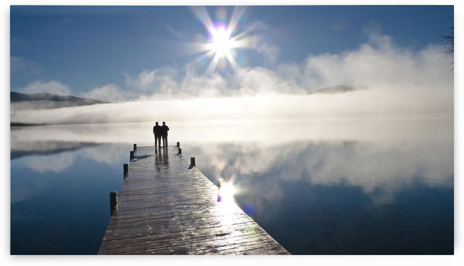 Couple Standing On A Dock And Silhouetted Against The Fog Lifting From Lake Whatcom During Winter, Bellingham Washington, Usa by PacificStock
