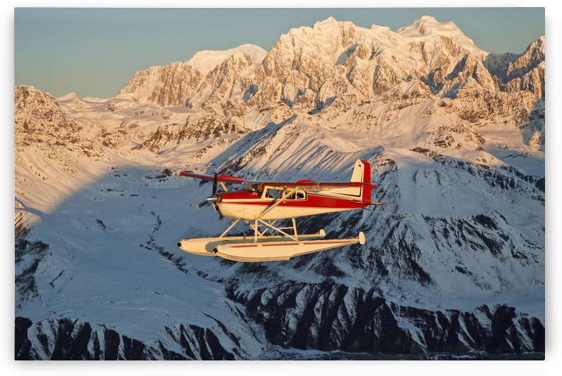 View Of A Cessna 185 Floatplane In Alaska Range Over Ruth Glacier At Sunset, Southcentral Alaska by PacificStock
