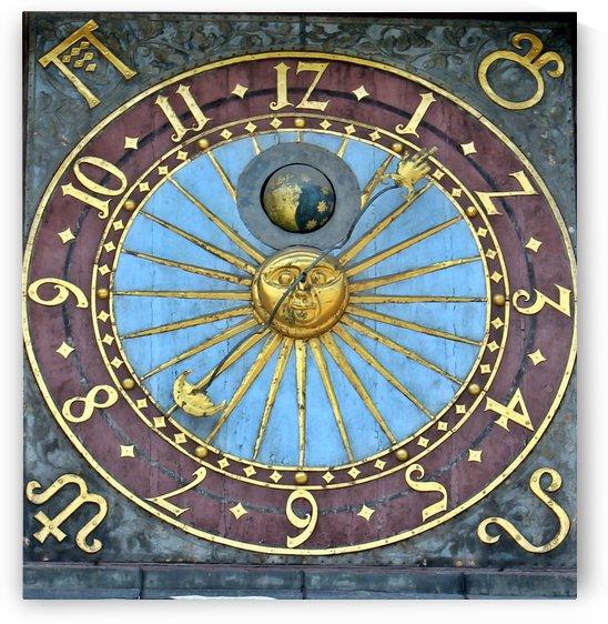 Medieval, golden sundial by Mariusz Wojcik