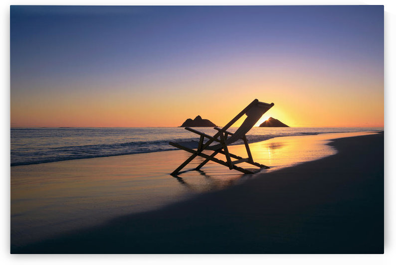 Hawaii, Lanikai, Empty beach chair at sunset. by PacificStock