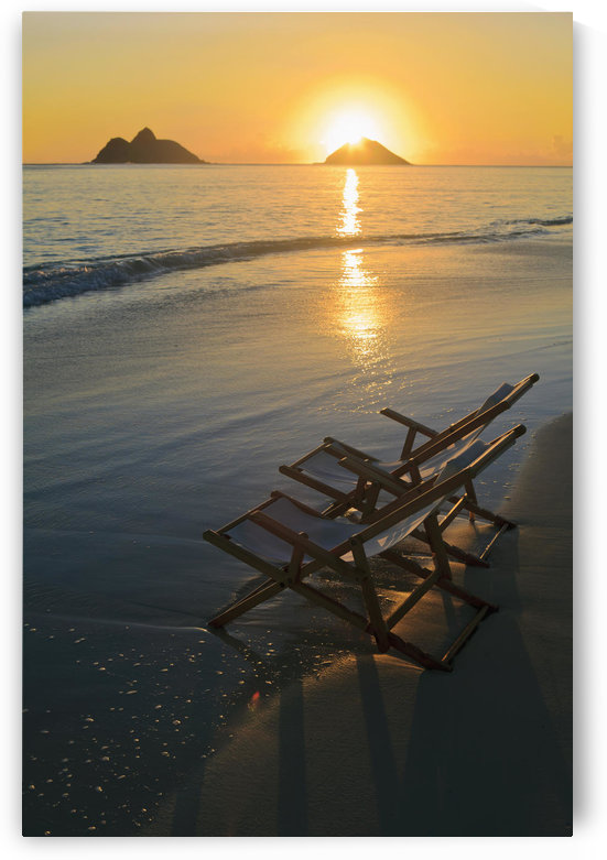 Hawaii, Lanikai, Pair of empty beach chairs at sunset. by PacificStock