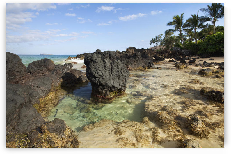 Hawaii, Maui, Makena, Beautiful clear ocean among lava rock. by PacificStock