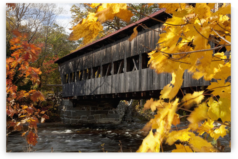 New England, New Hapshire, White mountains, A covered bridge over a river in Autumn. by PacificStock