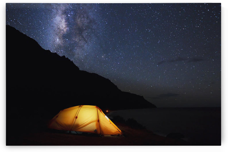 Hawaii, Kauai, Na Pali Coastline and Kalalau Mountains, Iluminated tent and star filled sky. by PacificStock