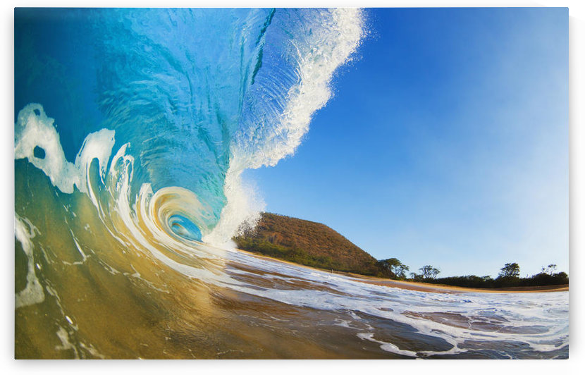 Hawaii, Maui, Makena, Beautiful blue ocean wave breaking at the beach. by PacificStock