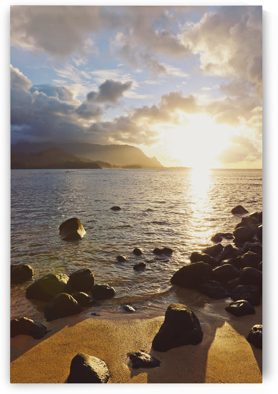 Hawaii, Kauai, Hanalei Bay, Dramatic sunset over ocean from beach. by PacificStock