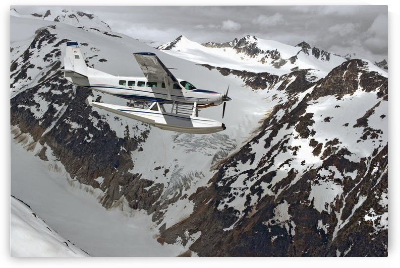 Cessna Caravan Amphibian Seaplane Flying Through The Coast Mountains; British Columbia Canada by PacificStock