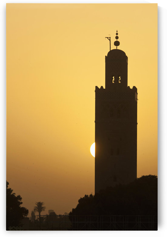 Morocco, Sun setting behind minaret of Koutoubia mosque; Marrakesh by PacificStock