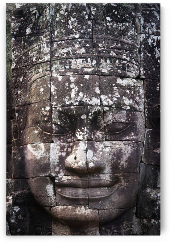 A face sculpture on a stone wall at angkor wat;Cambodia by PacificStock