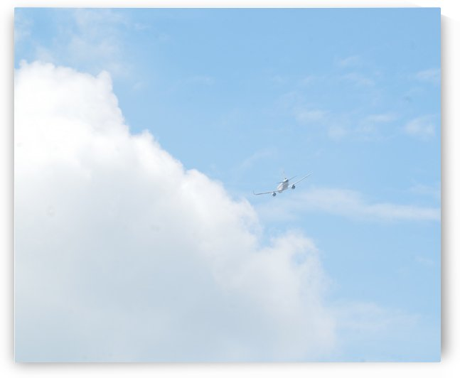 Aircraft banking into clouds. by Alan Skau