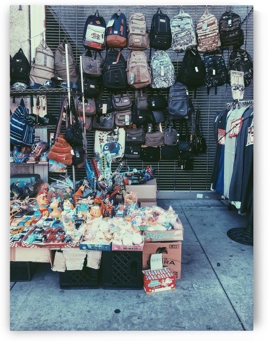 backpack and toy shop on the footpath by TimmyLA