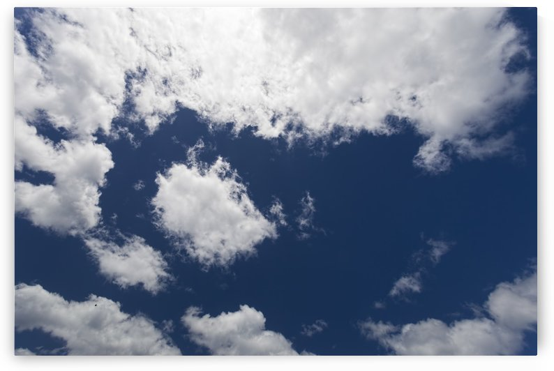 Blue Sky with White Clouds 011142579 by Maxwell Jordan