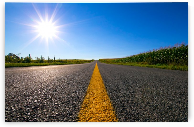 Yellow strip on the road by Rene Beaulieu