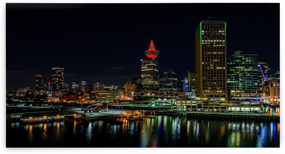 downtown at big megalopolis at night by Viktor Birkus