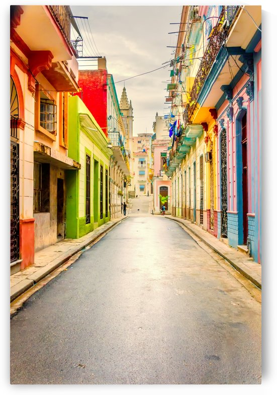 A long narrow, empty street in an old city with colorful houses by Viktor Birkus