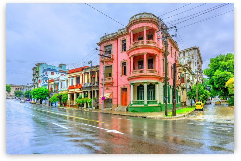 Ancient buildings in the street of Cuban Havana at noon after rain by Viktor Birkus