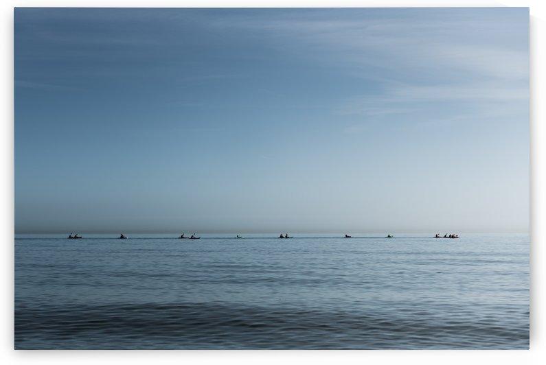 Canoe rowling by Ovidiu