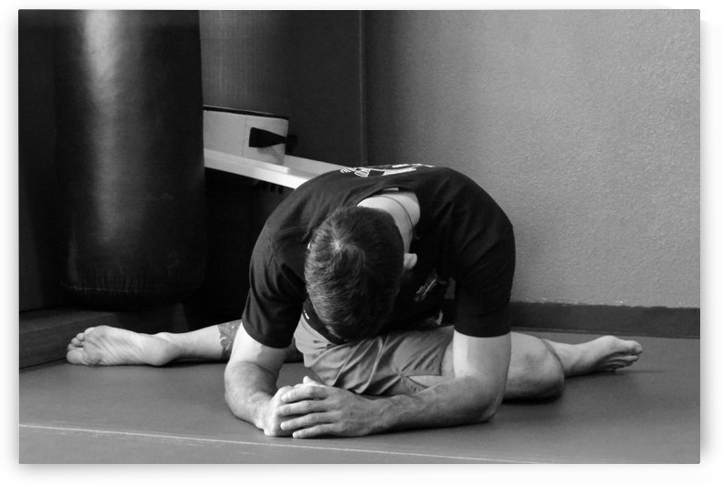 Man Stretching by Leah McPhail