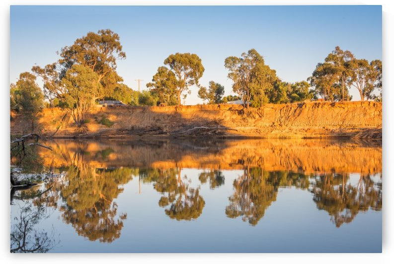 Tranquil river bank reflections at sunrise by Grant Cookson