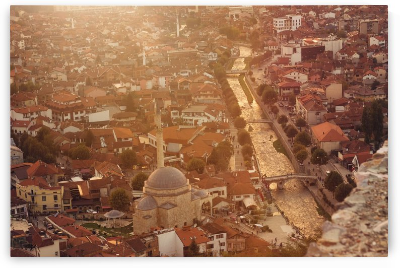 old and cultural city of Prizren Kosovo with the golden river in the evening sunshine by Besa Art