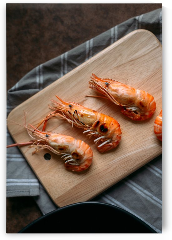 Shrimp on wooden board by Krit of Studio OMG
