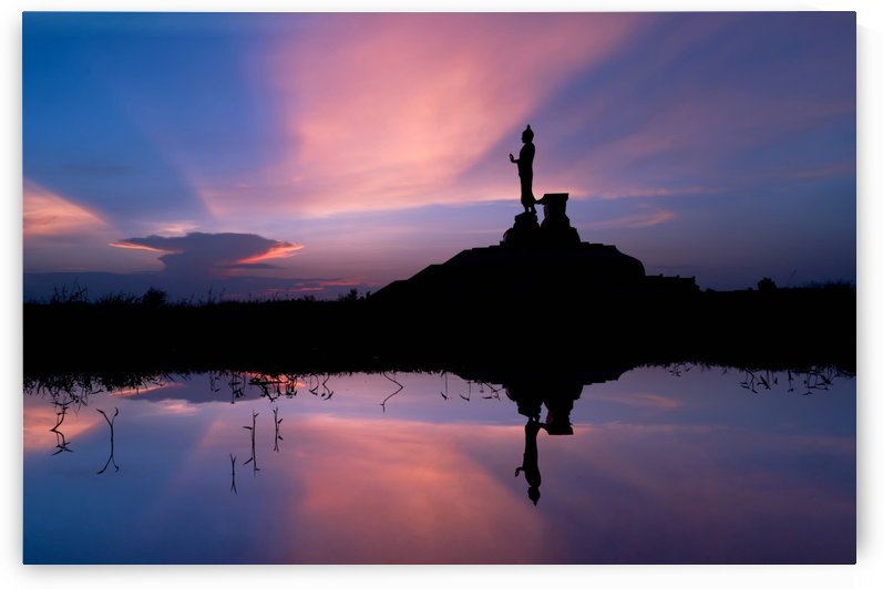 The silhouette of Buddha statue with vivid sky by Krit of Studio OMG