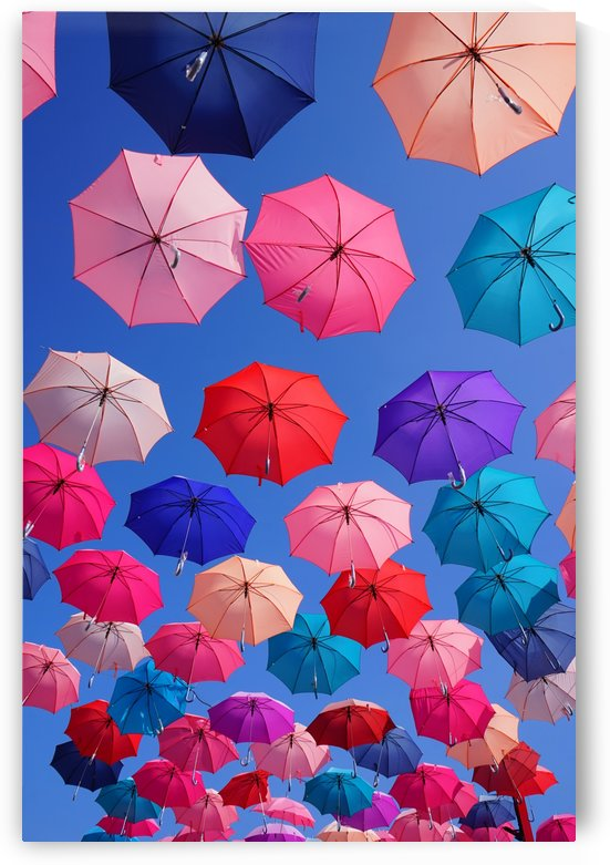 Colorful umbrella with blue sky by Krit of Studio OMG