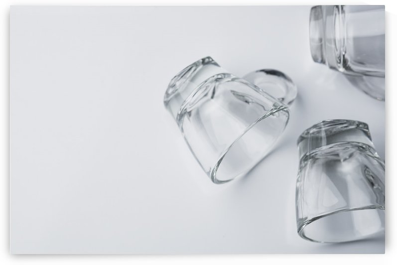 Drinking glasses on white table by Krit of Studio OMG