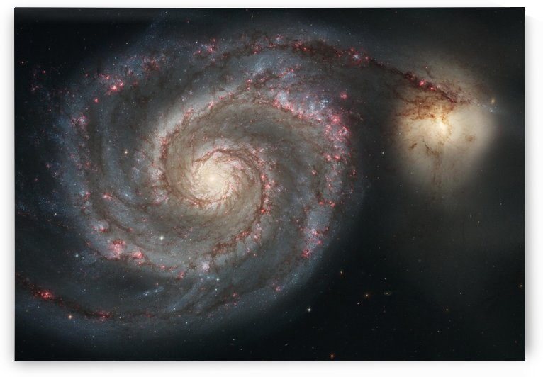 The whirlpool galaxy M51 and companion galaxy. by StocktrekImages