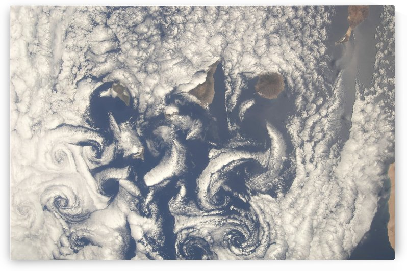 Cloud vortices in the area of the Canary Islands in the North Atlantic Ocean. by StocktrekImages
