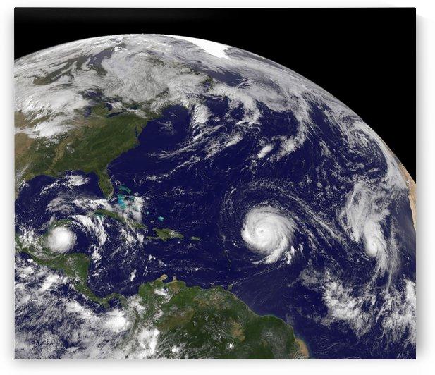 Three tropical cyclones active in the Atlantic Ocean basin. by StocktrekImages
