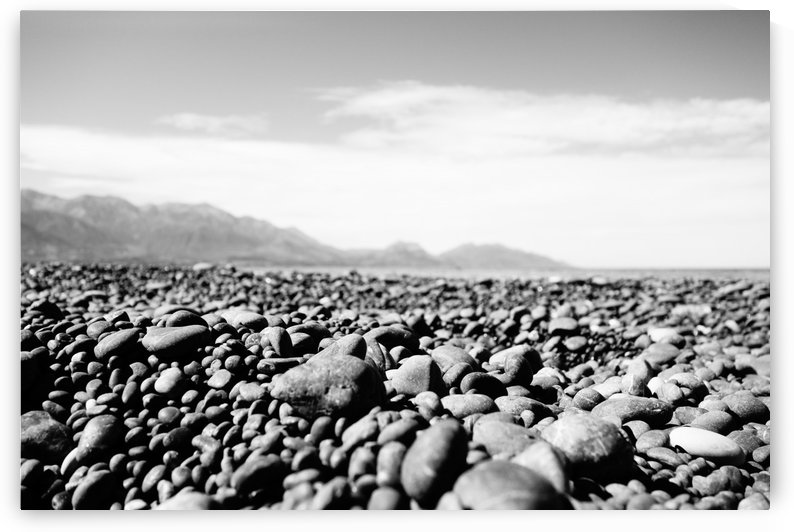 Pebbles on beach by Ben Conway