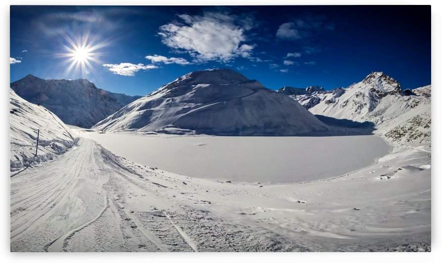 Panoramic View of Lake Rifflsee from the mountain in winter by zoltanduray