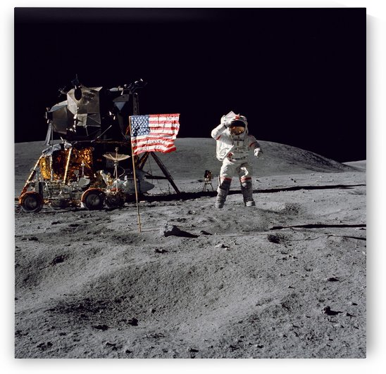 An astronaut stands next to the American flag during an Apollo 16 moonwalk. by StocktrekImages