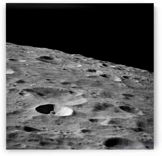 Leonove a small lunar crater on the far side of the moon. by StocktrekImages