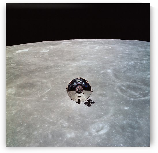 The Apollo 10 Command and Service Modules in lunar orbit. by StocktrekImages