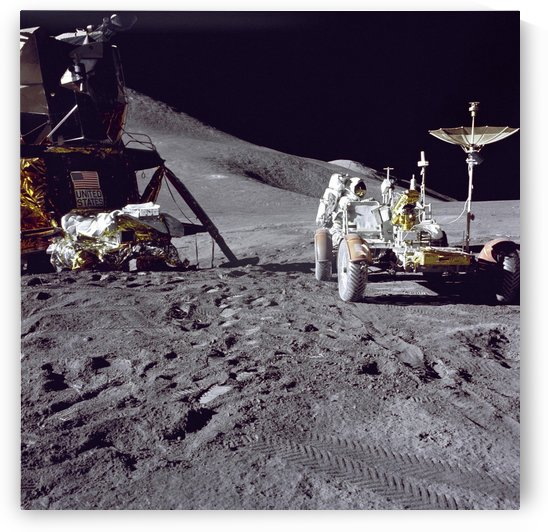 Apollo 15 astronaut loads the lunar rover with tools and equipment. by StocktrekImages