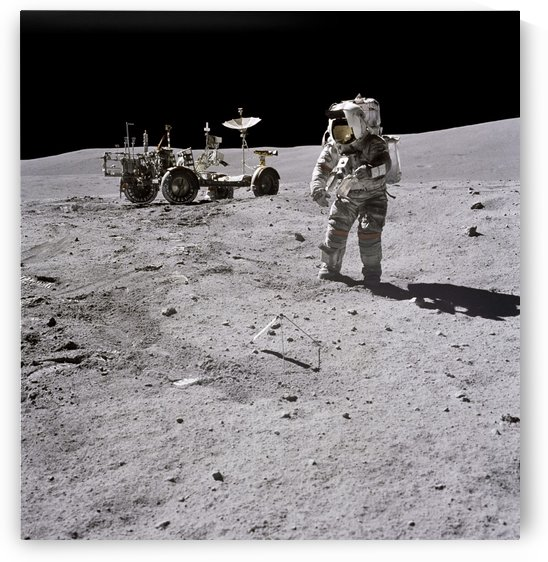 Apollo 16 astronaut collects samples on the lunar surface. by StocktrekImages