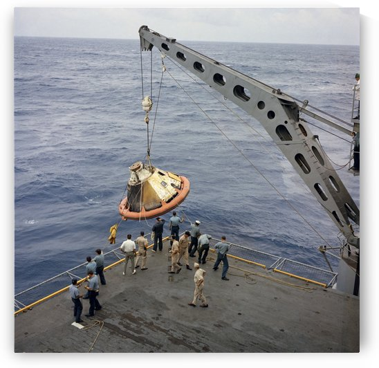 The Apollo Spacecraft command module is recovered aboard USS Bennington. by StocktrekImages