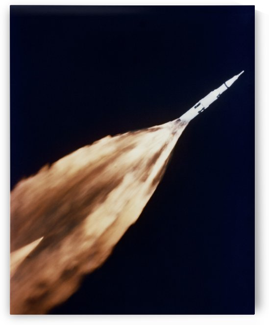 Apollo 6 spacecraft leaves a fiery trail in the sky after launch. by StocktrekImages