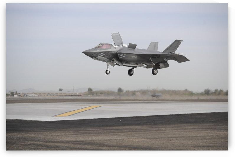 An F-35B Lightning II Joint Strike Fighter prepares to make a vertical landing. by StocktrekImages